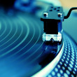 Turntable playing vinyl record - Stok fotoğraf