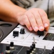 Hands of a dj adjusting the crossfader - Stok fotoğraf