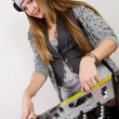 Stock Photo: Young female hip-hop dj playing