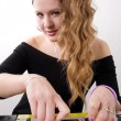 Stock Photo: Young female dj playing