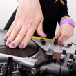Hands of female hip-hop DJ scratching — Stock Photo