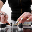 Stock Photo: Hands of female DJ playing