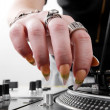 Hands of female DJ puting needle on record - Stockfoto