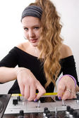 Young female dj playing — Stock Photo
