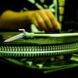 DJ playing music from vinyl record - Stock Photo