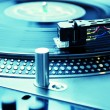 Stock Photo: Turntable playing vinyl record with music
