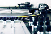 Turntable playing vinyl music record — Stock Photo