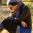 Young girl with a kitty outdoors — Stock Photo