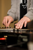 Hands of a DJ playing vinyl — Stock Photo