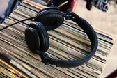 Headphones on vinyl records — Stock Photo