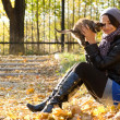 Young girl with a kitten outdoors — Stock Photo