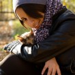 Young girl with a cat outdoors — Stock Photo