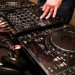 Hands of a Dj playing music — Stock Photo