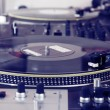 Turntable playing vinyl music record — Stock Photo #4929253