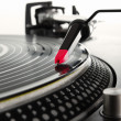 Turntable playing vinyl record with music - Stock Photo
