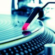 Turntable playing vinyl with music — Stock Photo #5341317