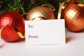Blank christmas paper tag with color ball — Foto de Stock