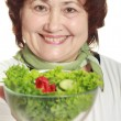 Mature womwith fresh salad — Stock Photo #5031006