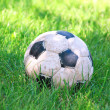 Royalty-Free Stock Photo: Old soccer ball on grass