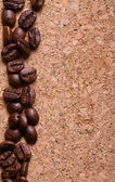 Coffee beans on a corkwood texture background — Stock Photo