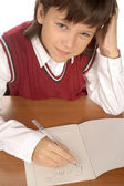 Schoolboy writing formula — Stock Photo