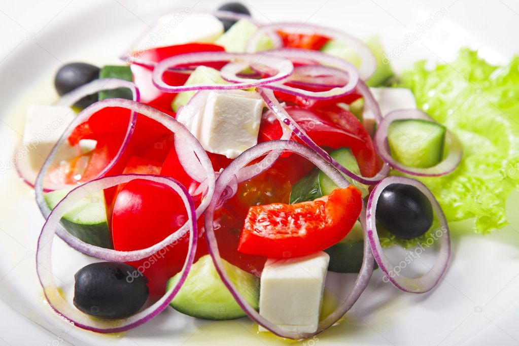 Fresh Greek salad on white plate — Stock Photo #4450640