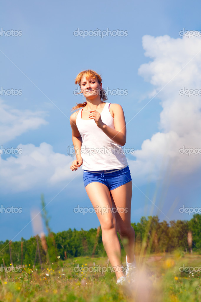 Young happy girl running on sunny meadow  Stock Photo #4776700