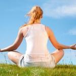 Girl training yoga — Stock Photo #4801642