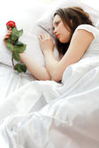 Girl in the bed — Stock Photo