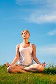 Girl training yoga — Stock Photo