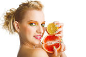 Woman with grapefruit — Stock Photo