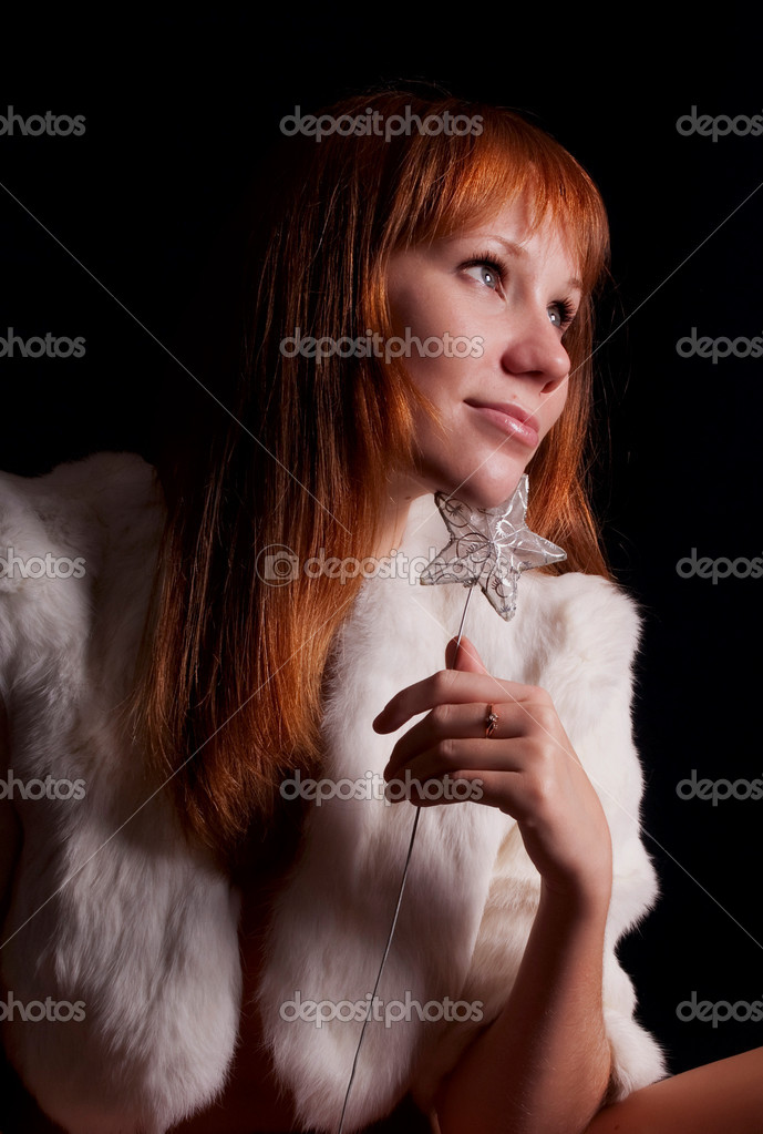 Smiling redhead woman on a black background  Stock Photo #4024121