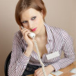 Office worker with phone — Stockfoto