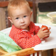 Kid eats a tomato — Stock Photo #5283529