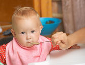 Baby food with a spoon — Stock Photo