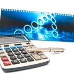 Calculator and a pen — Stock Photo