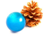 Christmas ball with a gold pine cone — Stock Photo