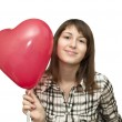 Girl with balloon in the form of heart — Stock Photo #4911085