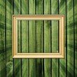 Empty frame on wooden wall — Stock Photo