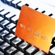 Credit card on keyboard — Stock Photo