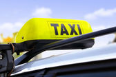 Yellow taxi sign — Stock Photo