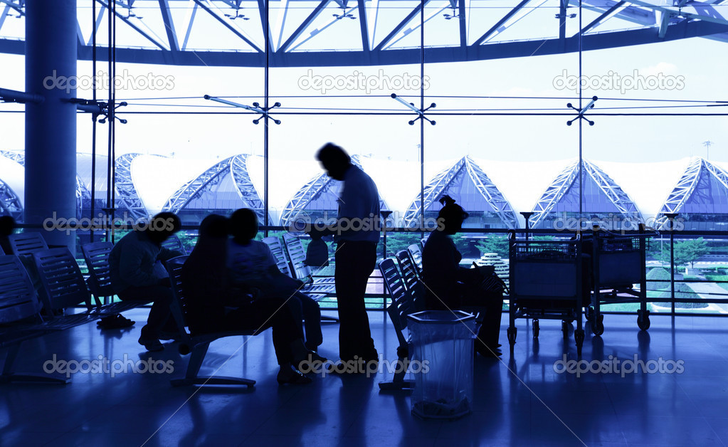 Passengers at airport, toned in blue color — Stock Photo #4550307