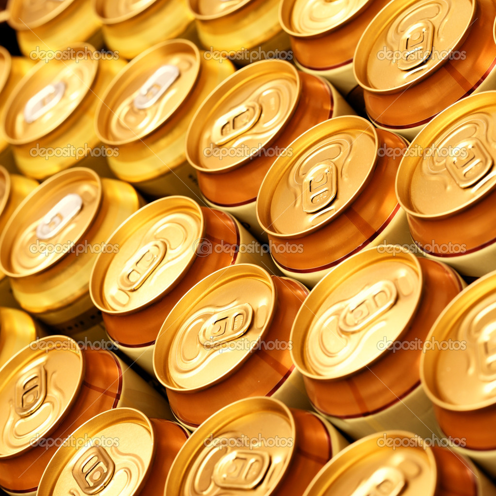 Much of gold beer cans close up — Stock Photo #4553313