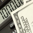 Dollars and calculator - Foto Stock