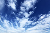 Blue sky with fleecy clouds — Stok fotoğraf