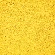 Yellow stucco texture — Stock Photo