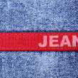 Blue jeans with red label — Stock Photo #4580289