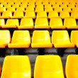 Yellow plastic seats - Stock Photo
