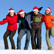 Friends with Santa hats have fun — Stock Photo