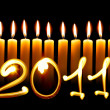 Stock Photo: 2011 - Twelve alight candles